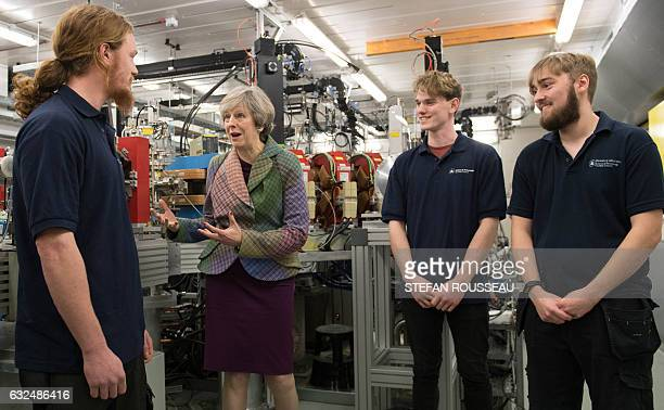 British Prime Minister Theresa May meets technicians during a visit to SkiTech Daresbury in Warrington north west England on January 23 2017 British...