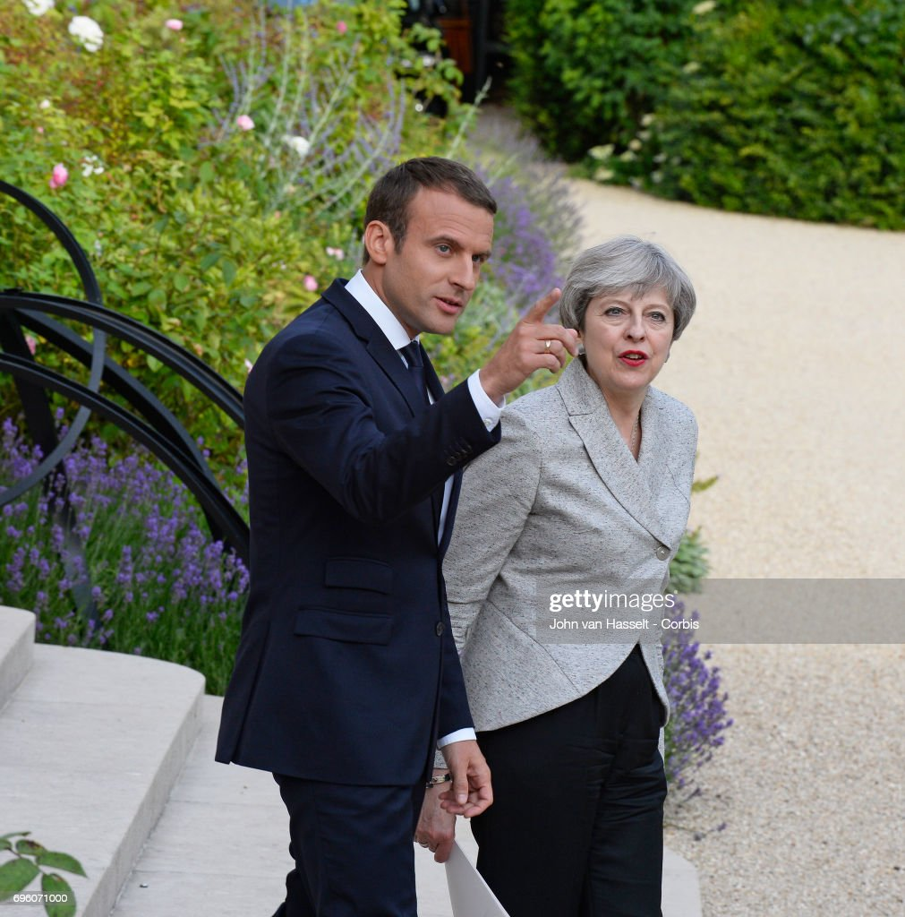 British Prime Minister Theresa May (R) meets with the newly elected president of France Emmanuel Macron at the Elysée Palace on June 13, 2017 in Paris, France. The main subjects of discussion will be Brexit and how to fight terrorism.