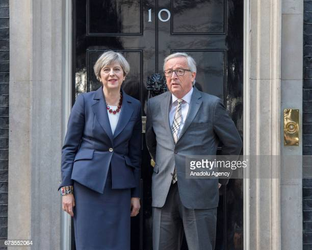 British Prime Minister Theresa May poses for a photo with European Union Commission President Jean Claude Juncker during their meeting in Downing...