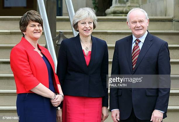 British Prime Minister Theresa May poses for pictures with Northern Ireland's First Minister Arlene Foster and Deputy First Minister Martin...