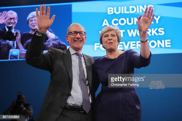 British Prime Minister Theresa May poses with husband Philip after delivering her keynote speech to delegates and party members on the last day of...