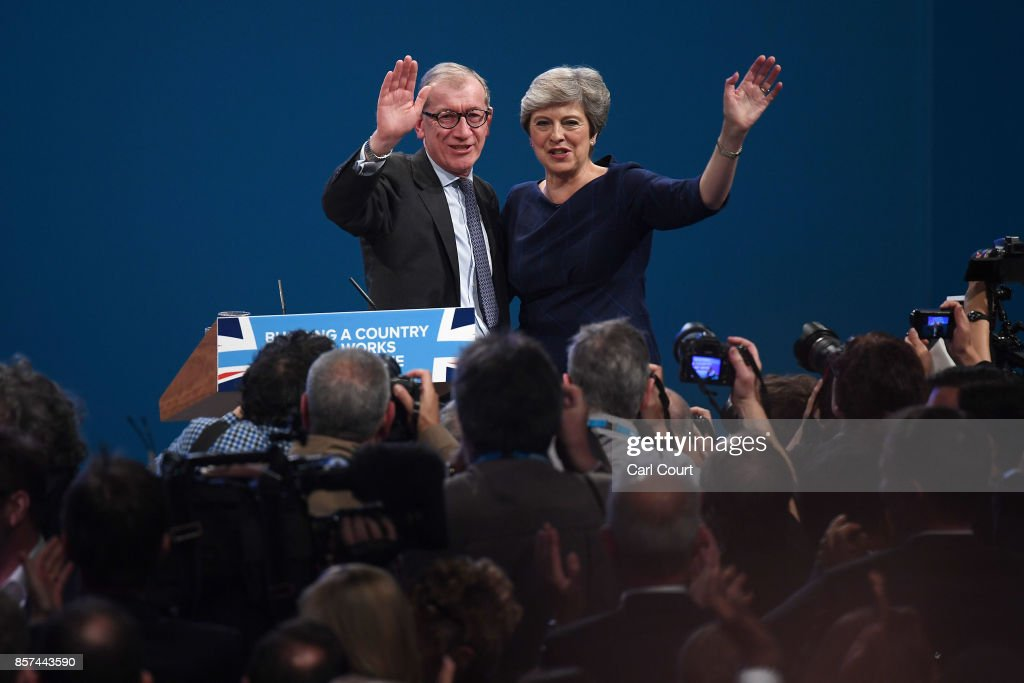 British Prime Minister Theresa May poses with husband Philip after delivering her keynote speech to delegates and party members on the last day of the Conservative Party Conference at Manchester Central on October 4, 2017 in Manchester, England. The prime minister rallied members and called for the party to 'shape up' and 'go forward together'. Theresa May also announced a major programme to build council houses and a cap on energy prices.