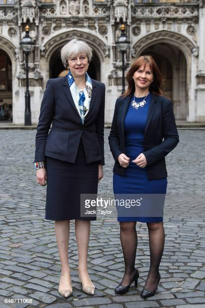 British Prime Minister Theresa May poses with newly elected Copeland MP Trudy Harrison outside the Houses of Parliament on March 1 2017 in London...