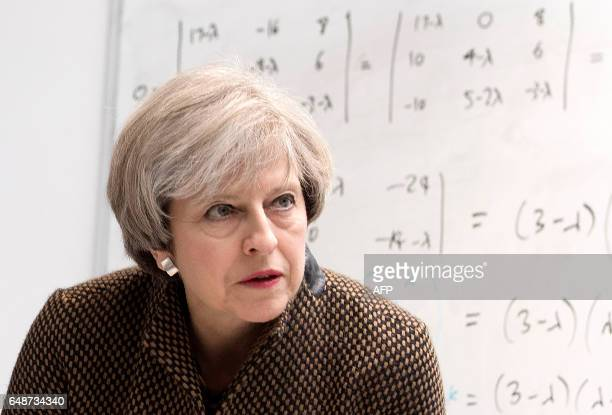 British Prime Minister Theresa May reacts during her visit to King's College London Mathematics School in central London on March 6 2017 British...