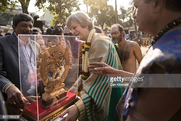 British Prime Minister Theresa May receives a gift after visiting the Sri Someshwara Temple on November 8 2016 in Bangalore India Mrs May is in India...