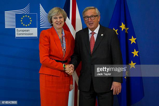 British Prime Minister Theresa May shakes hands with President of the European Commission JeanClaude Juncker at the European Commission at the end of...