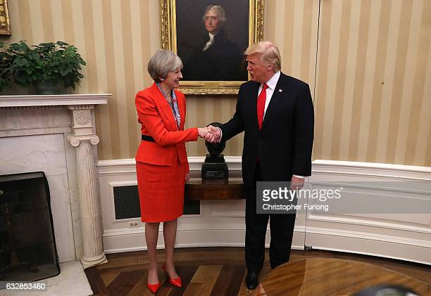 British Prime Minister Theresa May shakes hands with US President Donald Trump in The Oval Office at The White House on January 27 2017 in Washington...