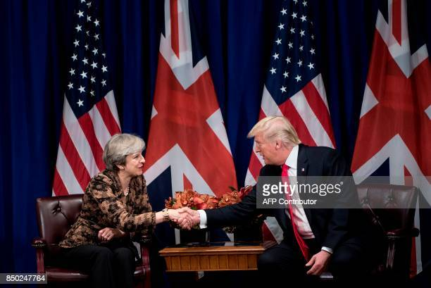 British Prime Minister Theresa May shakes hands with US President Donald Trump during their meeting at the Palace Hotel in New York City on the...