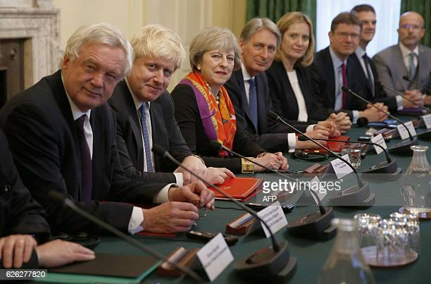 British Prime Minister Theresa May sits with memebers of her cabinet British Secretary of State for Exiting the European Union David Davis British...