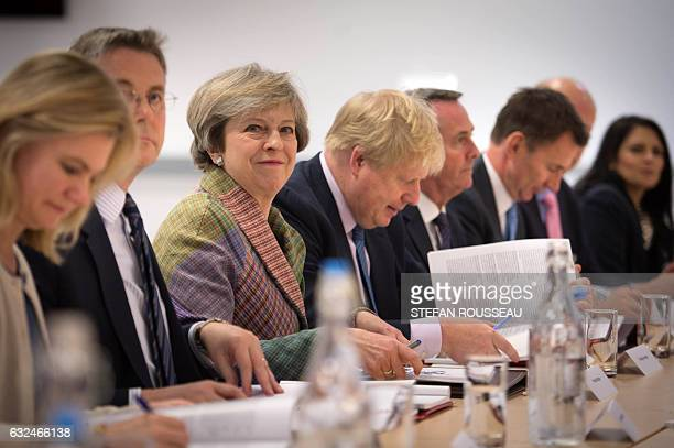 British Prime Minister Theresa May smiles as she holds a regional Cabinet meeting in Runcorn north west England on January 23 2017 Theresa May will...