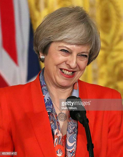 British Prime Minister Theresa May smiles during news conference with US President Donald Trump in the East Room of the White House January 27 2017...