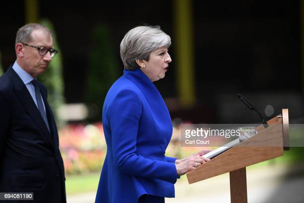 British Prime Minister Theresa May speaks after returning from Buckingham Palace outside 10 Downing Street on June 9 2017 in London United Kingdom...
