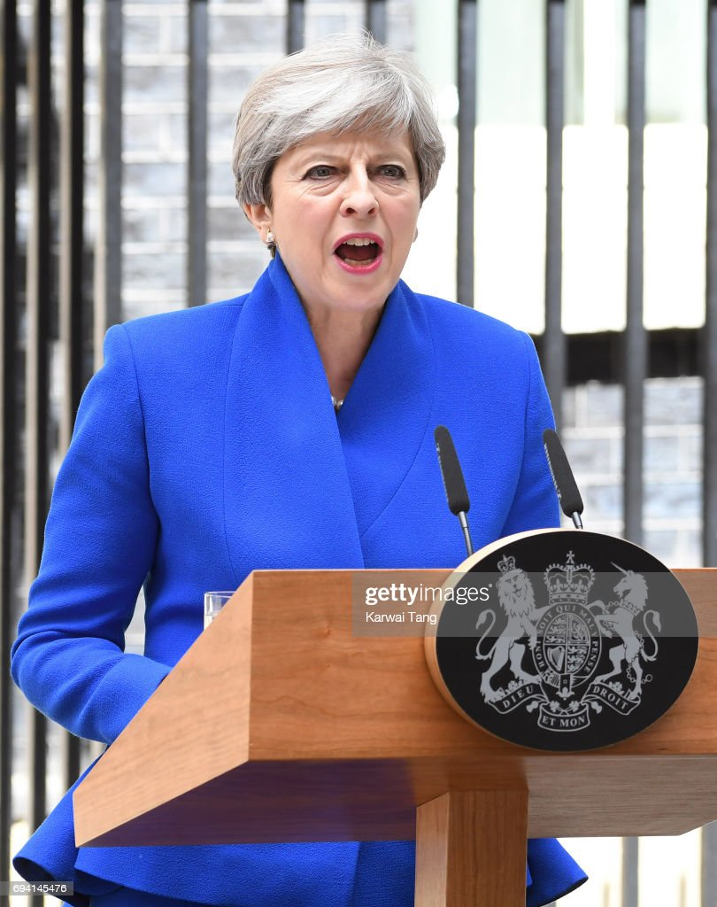 British Prime Minister Theresa May speaks after returning from Buckingham Palace outside 10 Downing Street on June 9, 2017 in London, England. After a snap election was called by Prime Minister Theresa May, the United Kingdom went to the polls yesterday. The closely fought election has failed to return a clear overall majority winner and a hung parliament has been declared.