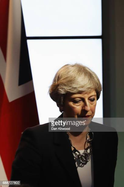 British Prime Minister Theresa May speaks at a press conference after attending the G7 summit on May 26 2017 in Taormina Italy During the summit...