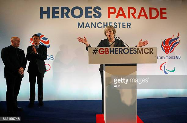 British Prime Minister Theresa May speaks at an event attended by members of Britain's Olympic and Paralympic teams at Manchester's town hall on...