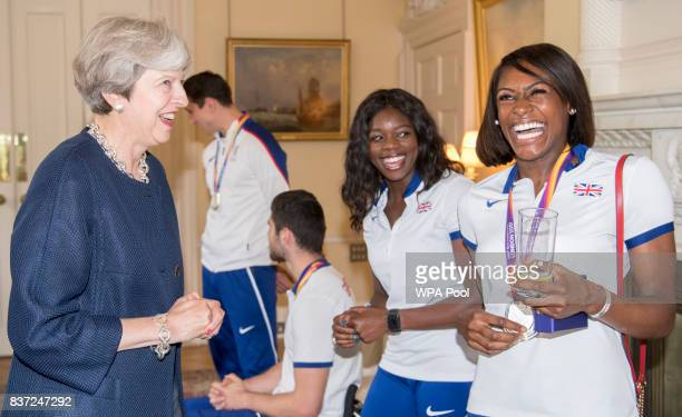 British Prime Minister Theresa May speaks to Perri ShakesDrayton and Asha Philip a reception for who competed in the World Athletics Championships...