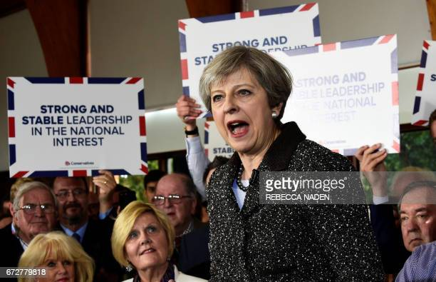 British Prime Minister Theresa May speaks to supporters at the Brackla community centre in Bridgend south Wales on April 25 in the buildup to the...