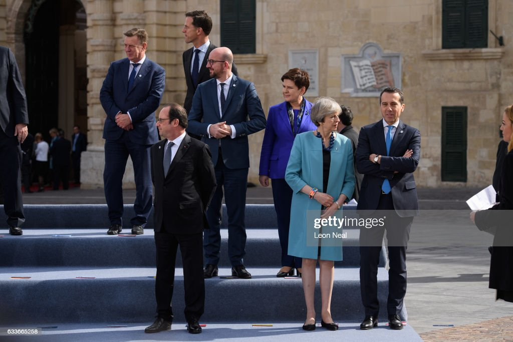 British Prime Minister Theresa May (2R) speaks to the Federal Chancellor of Austria Joseph Muscat (R) ahead of the family photo at the EU Informal Summit on February 3, 2017 in Valletta, Malta. Theresa May attends an informal summit of the 27 EU leaders to brief them on her recent meeting with President Trump. She has secured a guarantee from Trump that he is 100% supportive of NATO and she will encourage the EU countries to contribute the agreed 2% of their GDP on defence.