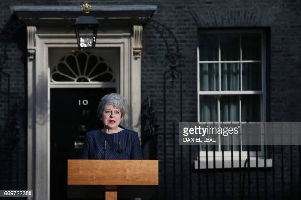 British Prime Minister Theresa May speaks to the media outside 10 Downing Street in central London on April 18 2017 British Prime Minister Theresa...
