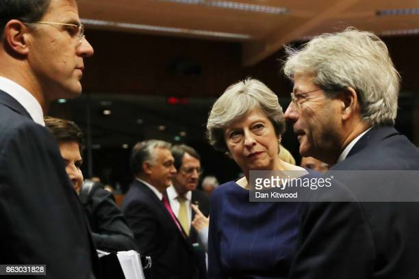 British Prime Minister Theresa May speaks with her counterparts ahead of a European Council Meeting at the Council of the European Union building on...