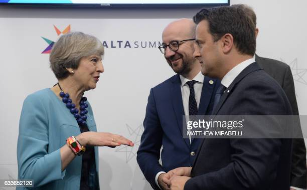 CORRECTION British Prime Minister Theresa May speaks with Prime Minister of Luxembourg Xavier Bettel and Prime Minister of Belgium Charles Michel at...