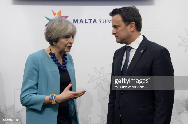 British Prime Minister Theresa May speaks with Prime Minister of Luxembourg Xavier Bettel at the first meeting of an Informal summit of EU heads of...