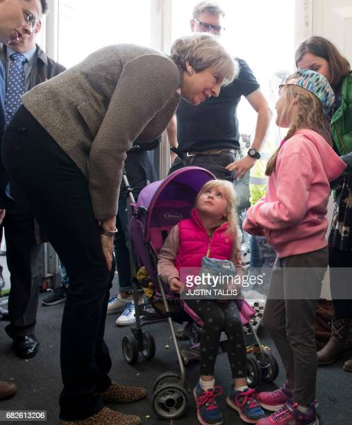 British Prime Minister Theresa May speaks with visitors at the Balmoral Show near Lisburn Northern Ireland on May 13 2107 during a general election...