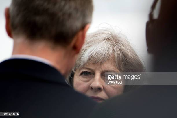British Prime Minister Theresa May speaks with visitors at the Balmoral Show during a general election campaign visit on May 13 in Lisburn Northern...