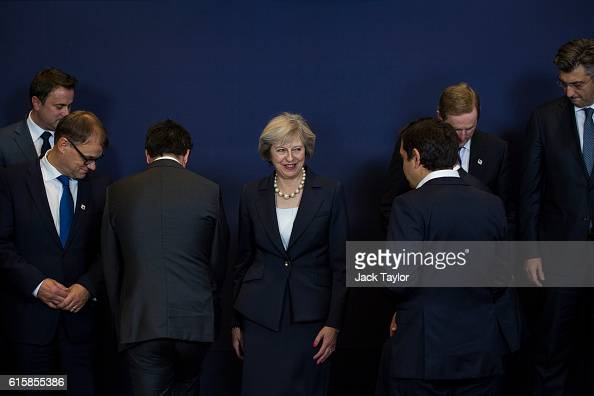 British Prime Minister Theresa May stands in position as other leaders of European Union countries assemble for a group photo at the Council of the...