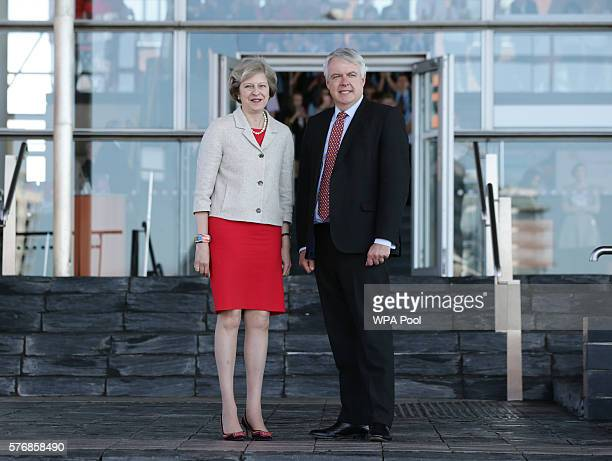 British Prime Minister Theresa May stands with the First Minister of Wales Carwyn Jones AM prior to a bilateral meeting at the Senedd the National...