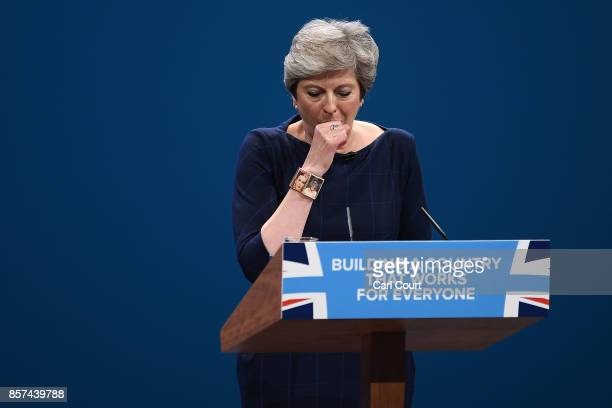 British Prime Minister Theresa May struggles with a cough as she delivers her keynote speech to delegates and party members on the last day of the...