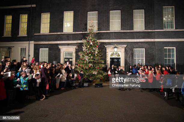 British Prime Minister Theresa May switches on the Christmas tree lights outside 10 Downing Street on December 6 2017 in London England Mrs May was...