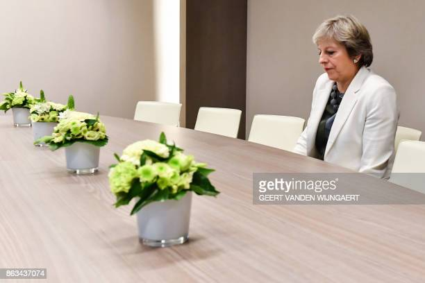 TOPSHOT British Prime Minister Theresa May takes a seat as she arrives for a bilateral meeting with European Council President Donald Tusk during an...