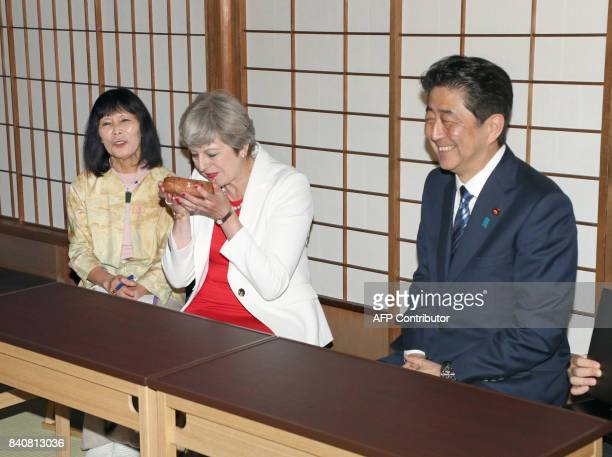 British Prime Minister Theresa May takes part in a tea ceremony with Japanese Prime Minister Shinzo Abe at Omotesenke Fushin'an in Kyoto western...