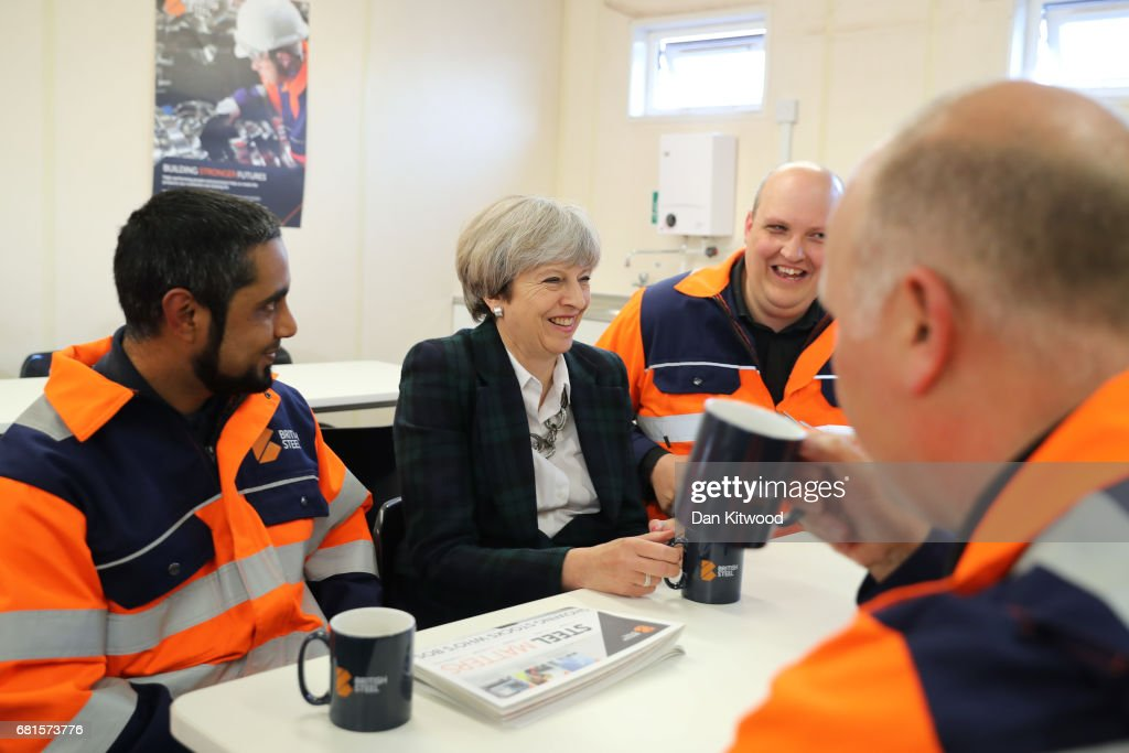 British Prime Minister Theresa May talks to staff in a tea room at British Steel as she campaigns in North Lincolnshire on May 10, 2017 in Scunthorpe, England. Campaigning is underway ahead of the general election which is to be held on June 8.