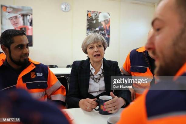British Prime Minister Theresa May talks to staff in a tea room at British Steel as she campaigns in North Lincolnshire on May 10 2017 in Scunthorpe...