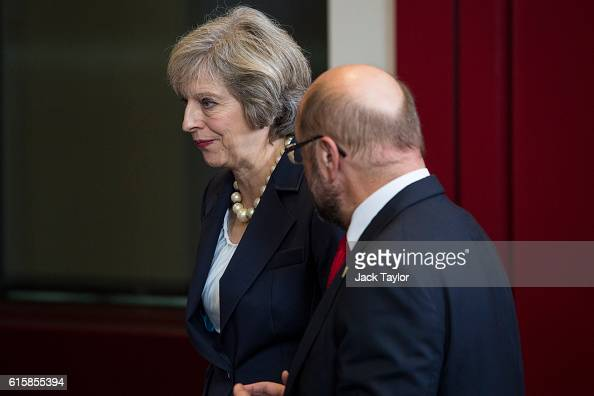 British Prime Minister Theresa May talks with President of the European Parliament Martin Schulz ahead of a group photo at the Council of the...