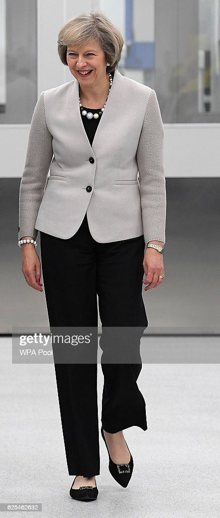British Prime Minister, Theresa May tourS the Renishaw innovation and engineering plant on November 24, 2016 in Wootton, England.