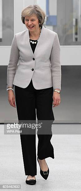 British Prime Minister Theresa May tourS the Renishaw innovation and engineering plant on November 24 2016 in Wootton England