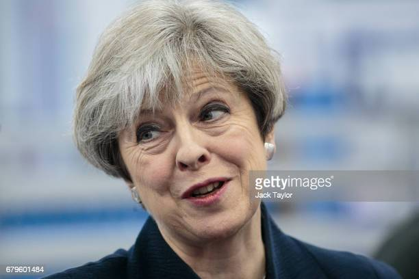 British Prime Minister Theresa May tours the UTC Aerospace Systems factory during a campaign visit on May 6 2017 in Wolverhampton England Campaigning...