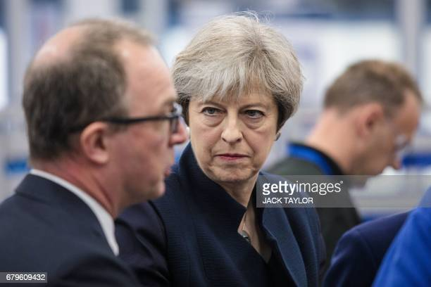 British Prime Minister Theresa May tours the UTC Aerospace Systems factory in Wolverhampton central England on May 6 as campaigning continues in the...