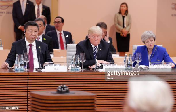 British Prime Minister Theresa May US President Donald Trump and Chinese President Xi Jinping at the first session of the G20 summit on July 7 2017...