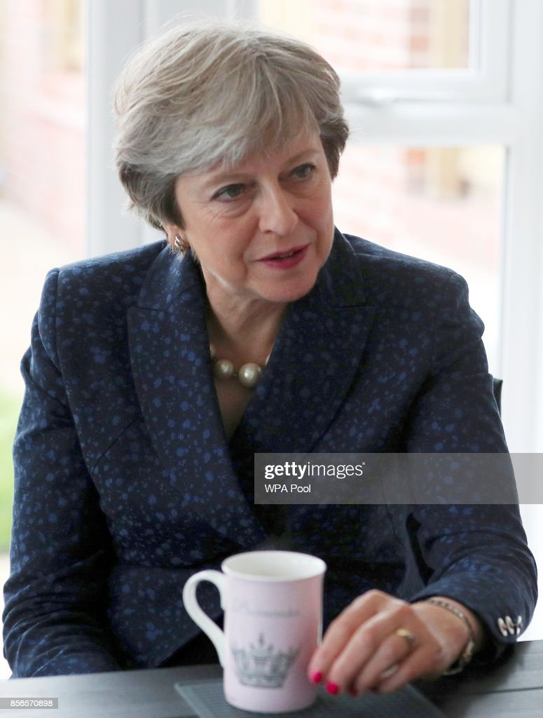 British Prime Minister Theresa May visitis a home in Walkden, near the Conservative Party's conference on October 2, 2017 in Manchester, United Kingdom.