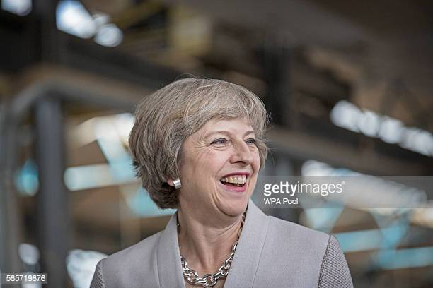 British Prime Minister Theresa May visits Martinek joinery factory on August 3 2016 in London United Kingdom