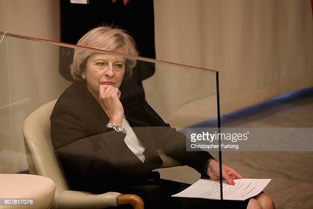 British Prime Minister Theresa May waits to take to the podium to address delegates with her keynote speech on the refugee crisis at the United...