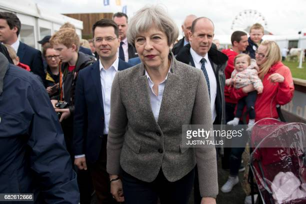British Prime Minister Theresa May walks around at the Balmoral Show near Lisburn Northern Ireland on May 13 2107 during a general election campaign...