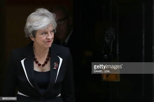 British Prime Minister Theresa May walks out of 10 Downing street to greet Israeli Prime Minister Benjamin Netanyahu in London on November 2 2017...