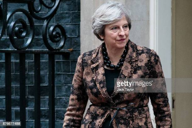 British Prime Minister Theresa May walks out of 10 Downing Street to greet Ghana's President Nana AkufoAddo on November 20 2017 in London England...