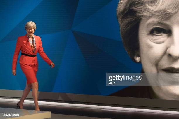 TOPSHOT British Prime Minister Theresa May walks out to take part in the 'May v Corbyn Live The Battle for Number 10' Sky News and Channel 4 event in...