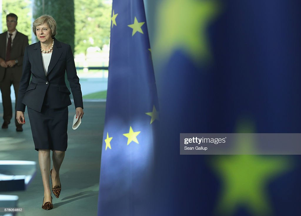 British Prime Minister Theresa May walks past European Union flags as she and German Chancellor Angela Merkel (not pictured) arrive to speak to the media following talks at the Chancellery on July 20, 2016 in Berlin, Germany. May, who replaced David Cameron as prime minister last week in the wake of the Brexit vote that will take the United Kingdom out of the European Union, is visiting Germany and France in her first foreign trip since assuming office.